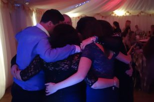 Full of Christmas Spirit sharing a hug on the dancefloor at Gwel an Mor, December 2015