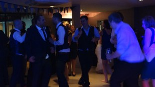 Groom and his groomsmen taking over the dancefloor at Grace & Luke's Wedding, Llawnroc Hotel, November 2015