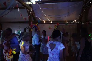 Some Guests have found big balloon hats to dance with at Laura & Danny's Wedding, Nancarrow Farm, August 2015