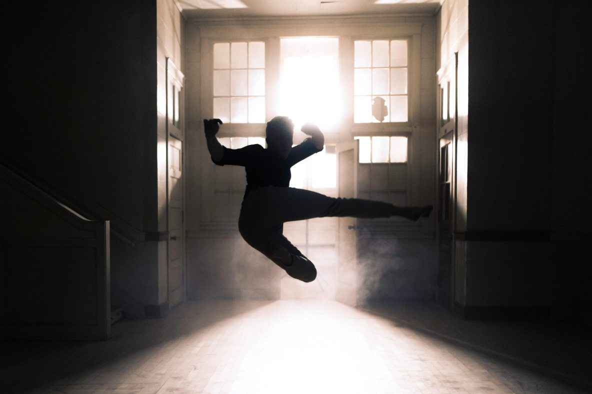 "Silhouette of a person doing a jump kick to represent ""kickass social media consultant"""