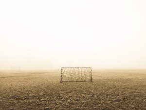 A goal on a field, representing social media goals and KPIs