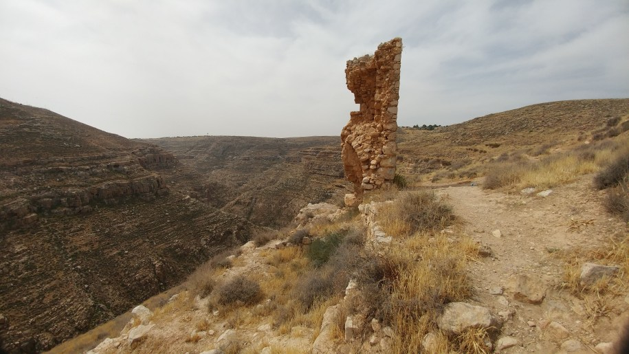 Remains of haritoun ancient monastery, rubble in pillar shape, towers over steep tekoa canyon