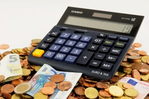 coins and cash with calculator, idea of money