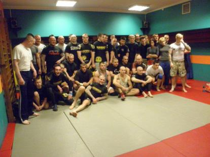 Niko (lying at front) posing at seminar in 2011 in Lublin, Poland. Individual in black 'Valhalla' t-shirt is Wojciech Cieplinski, another known Blood & Honour nazi