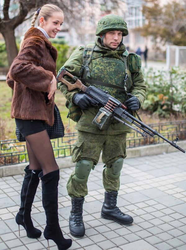 A Ukraine woman poses with a Russian Soldier in Sevastopol