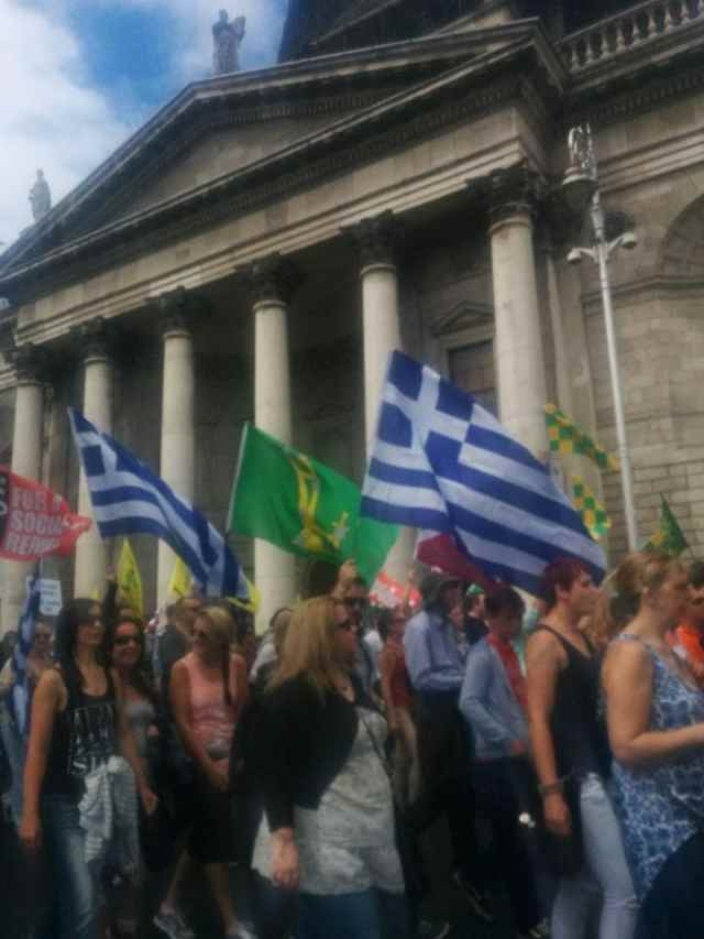 Irish anti-austerity protestors flying Greek flags in Dublin.
