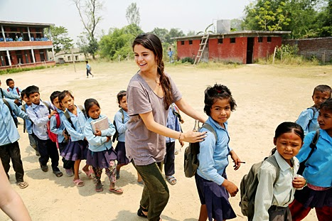 Selena-Gomez-Laughing-Enjoying-with-Children-in-Nepal