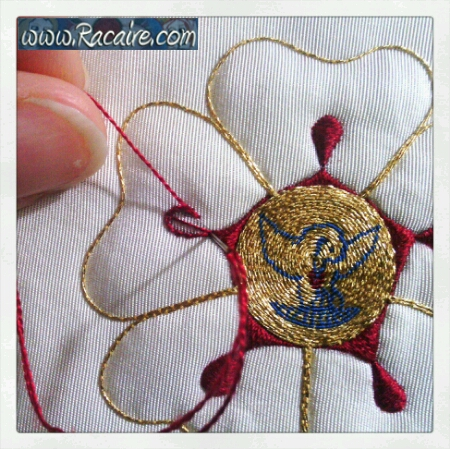 Finished pelican and border embellishment in progress