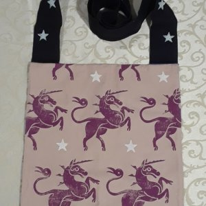 Bag made from pink and black handprinted cotton canvas, printed with hand carved unicorn and star stamps.