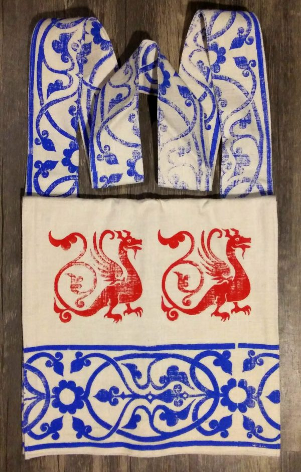 Bag made from white cotton fabric, lined with white cotton fabric & hand printed with hand carved 13th century dragon & decorative border stamp.