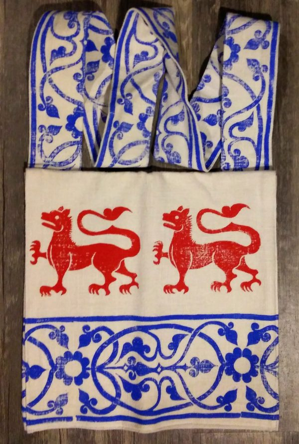 Bag made from white cotton fabric, lined with white cotton fabric & hand printed with hand carved 13th century lion & decorative border stamp.