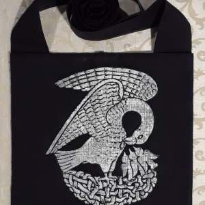 Bag made from black cotton fabric, lined, printed with a hand carved 15th century Pelican stamp in white.