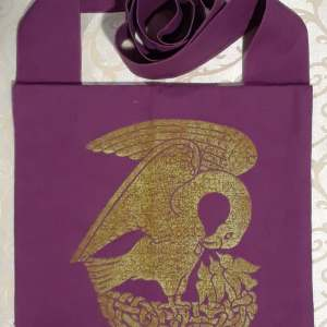 Bag made from magenta cotton fabric, lined, printed with a hand carved 15th century Pelican stamp in gold.