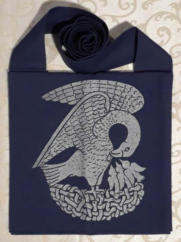 Bag made from blue cotton canvas, lined, printed with a hand carved 15th century Pelican stamp in silver.