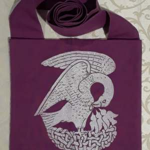 Bag made from magenta cotton fabric, lined, printed with a hand carved 15th century Pelican stamp in white.