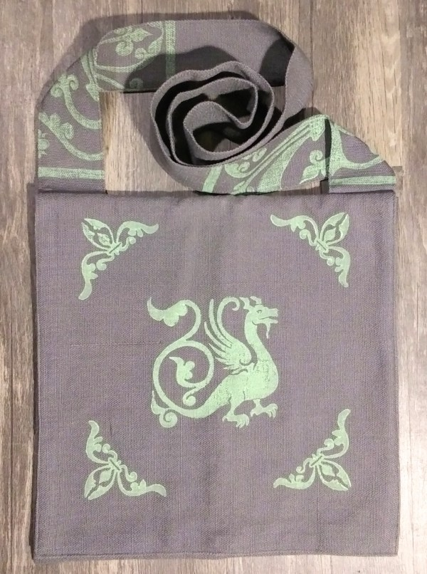 Bag made from grey cotton fabric, lined with white cotton fabric & hand printed in light green with a hand carved 13th century dragon and other medieval inspired stamps.