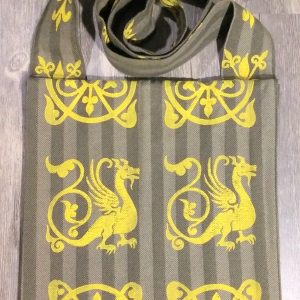 Bag made from green fabric, lined with yellow cotton fabric & hand printed in yellow with a hand carved 13th century dragon and other medieval inspired stamps.