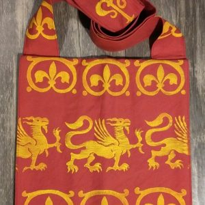 Bag made from red cotton fabric, lined with yellow cotton fabric & hand printed in yellow with a hand carved 13th century griffin and other medieval inspired stamps.