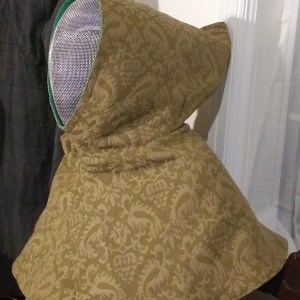 Reversible hood / SCA fencing mask hood cover, lined with green cotton canvas for extra safety. Hood is completely reversible and can be custom printed.
