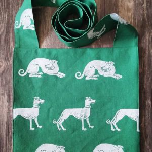 Handprinted dog bag made from green cotton canvas, lined with white cotton fabric, printed with hand carved 15th century inspired dog & greyhound stamp.
