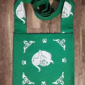 Cat bag made from green cotton canvas, lined with white cotton fabric & printed with hand carved 16th century butt-licking cat & cat paw print stamps.