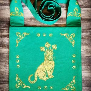 15th century catking bag made from green cotton canvas, lined with yellow cotton fabric and hand printed in gold with a hand carved 15th century inspired catking stamp.