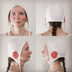 Small white cotton coif/arming cap made from slightly heavier natural white cotton fabric from one of the last American cotton mills, handprinted in red with a handcut medieval inspired rose stamp. Machine washable!