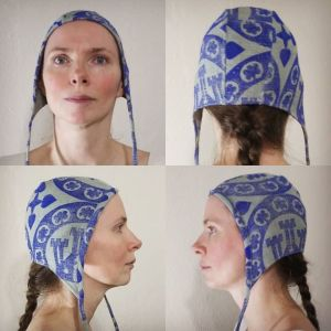 One of a kind small size silk coif/arming cap made from raw silk, handprinted in blue with handcut 13th century inspired castle roundel stamp.