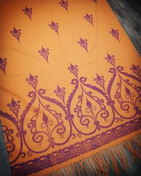 Soft, cozy & warm bright orange scarf with purple 12th century print. Hand printed with my own hand carved stamps. The scarf is new, pre-washed, ready to wear & machine washable!