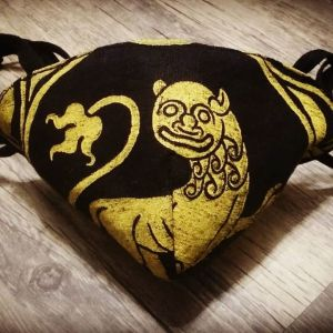 Black linen face mask with extra long ties and yellow 12th century lion print. New, pre-washed linen fabric, ready to wear and machine washable!