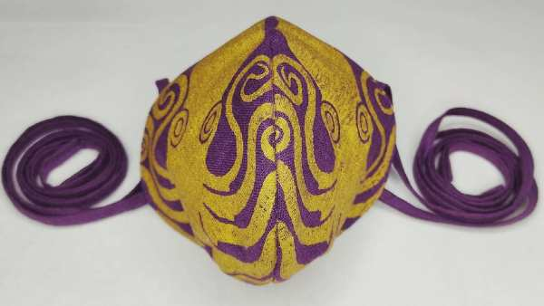 Purple/magenta colored linen octopus face mask with long ties and premium gold octopus print. New, pre-washed fabric, ready to wear and machine washable!