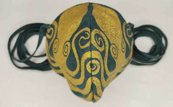 Dark green colored linen octopus face mask with long ties and premium gold octopus print. New, pre-washed fabric, ready to wear and machine washable!