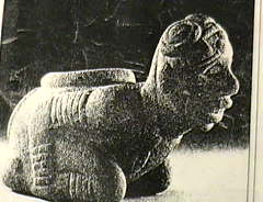 Stone carving of Negroid person