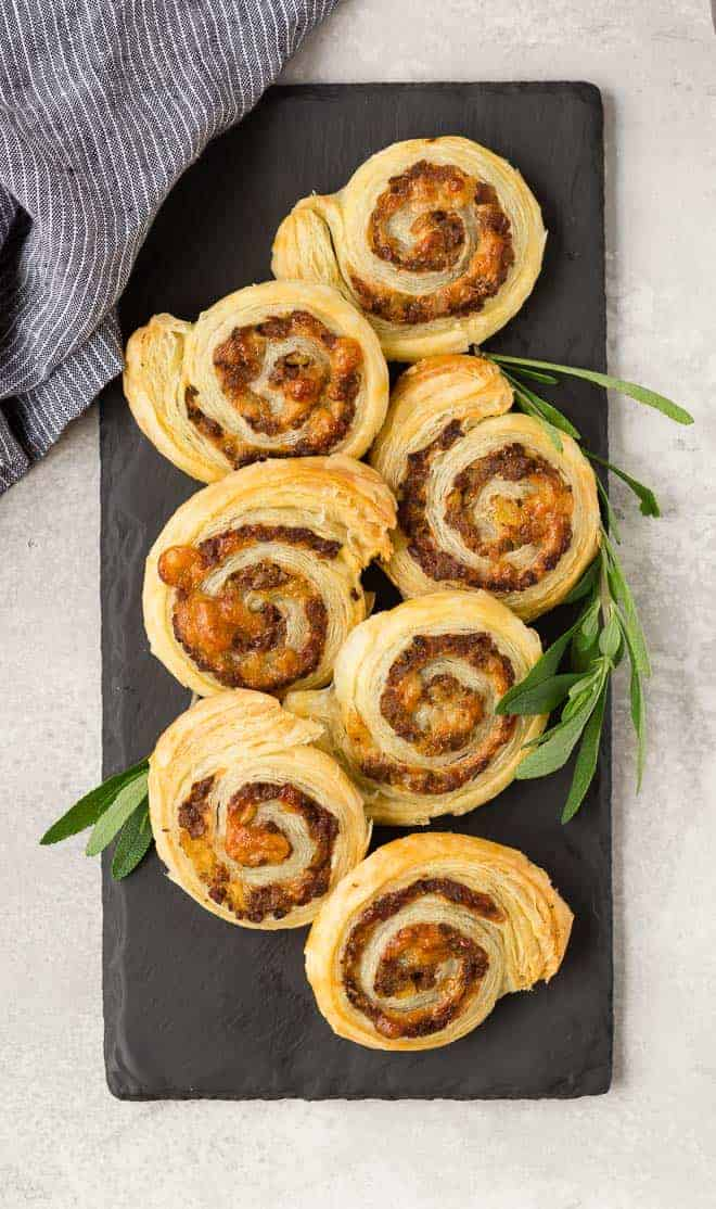 image of sausage puff pastry wheels made with apple and gruyere. The perfect holiday appetizer!