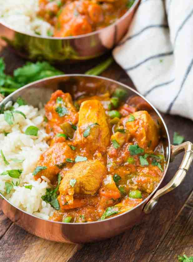 Easy tikka masala made with chicken and served with rice in copper bowls.