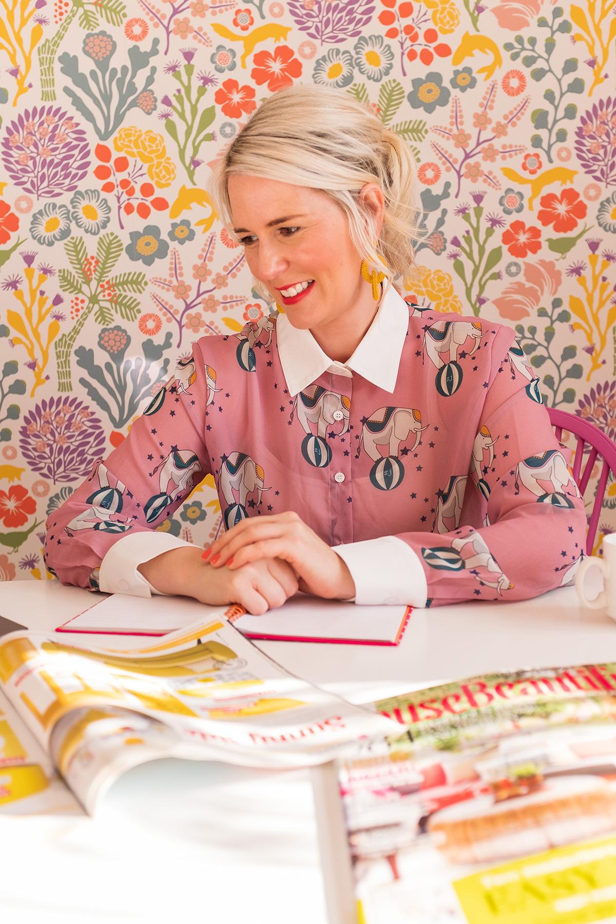 Rachel browsing through interior design magazines