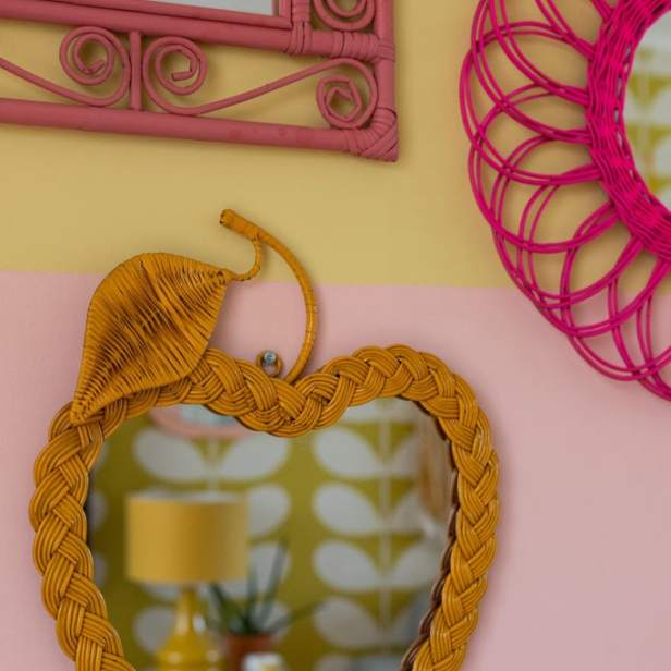 Wicker wall - close up of apple-shaped mirror