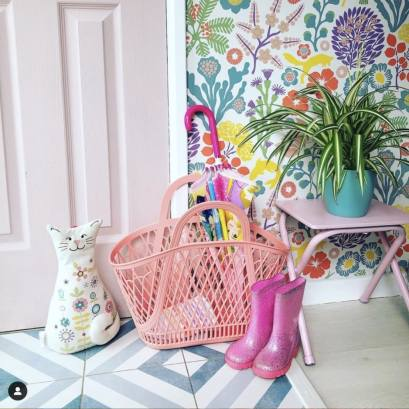 Pink wellies next to colourful hallway entrance