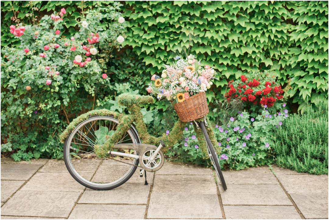 vintage bicycle decorated with flowers for a wedding at chiseldon house hotel