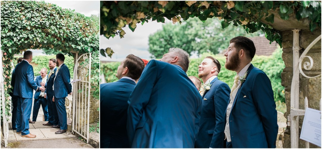 grooms and groomsmen standing under an archway waiting for the bride