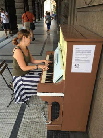 Playing a street piano in Prague