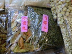In the center packet, jade green dried raisins from Turfan on sale in Taipei. Katy Biggs