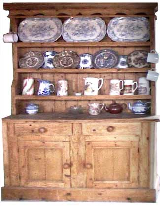 An Irish dresser with a fine display of china. http://www.museumsofmayo.com/belcarra/belcarra-dresser.htm