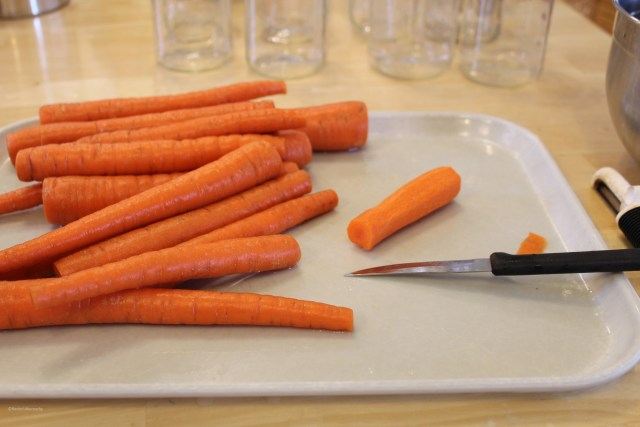Peeling and slicing carrots for making homemade fried carrots.