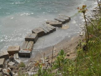 Rip rap at the base of a bluff along Lake Michigan is positioned to help ward off Lake Michigan waves.