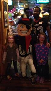 R.J. Raider with Deveron Davis and a young fan.