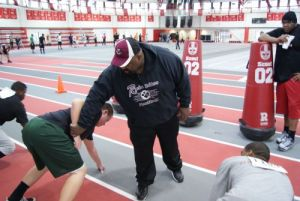 New Racine Raiders head coach Wilbert Kennedy provides some coaching to tryout participants in 2013.