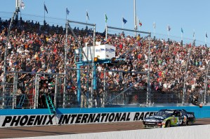 2010_Phoenix_Nov_NSCS_Carl_Edwards_crosses_finish_line