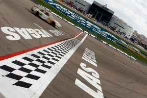 2011_Las_Vegas_NSCS_Carl_Edwards_crosses_finish_line