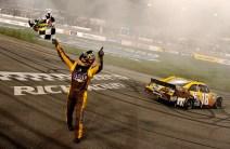 2012_Richmond_April_NASCAR_Sprint_Cup_Kyle_Busch_Waves_Checkered_Flag